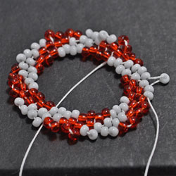 Step 5: Add one bead in between the beads strung in Round 4
