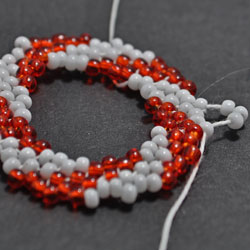 Step 6: Add three beads in between the beads strung in Round 5