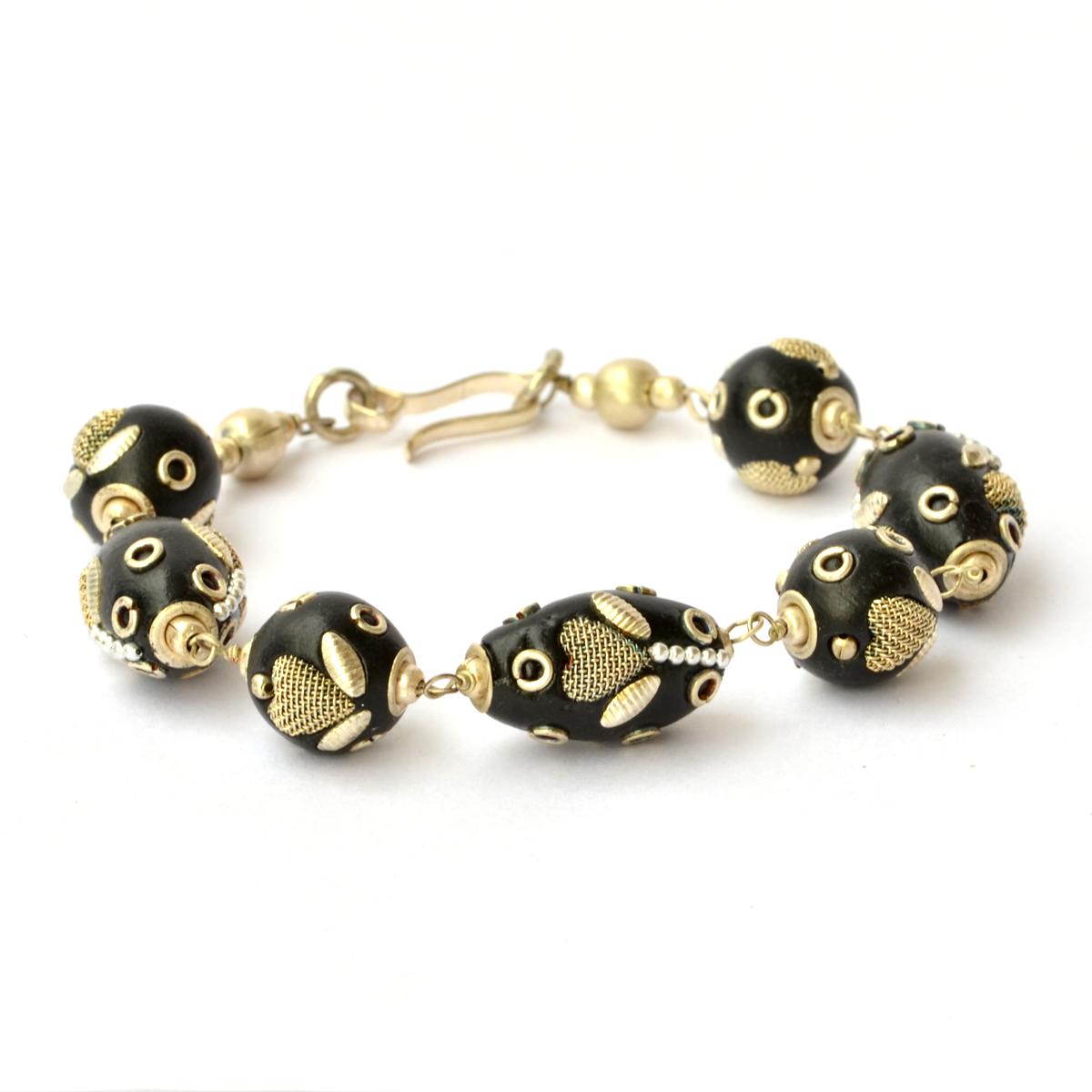 handmade bracelet black studded with metal