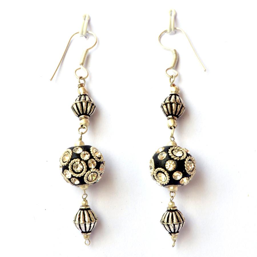Handmade earrings having black beads with metal rings