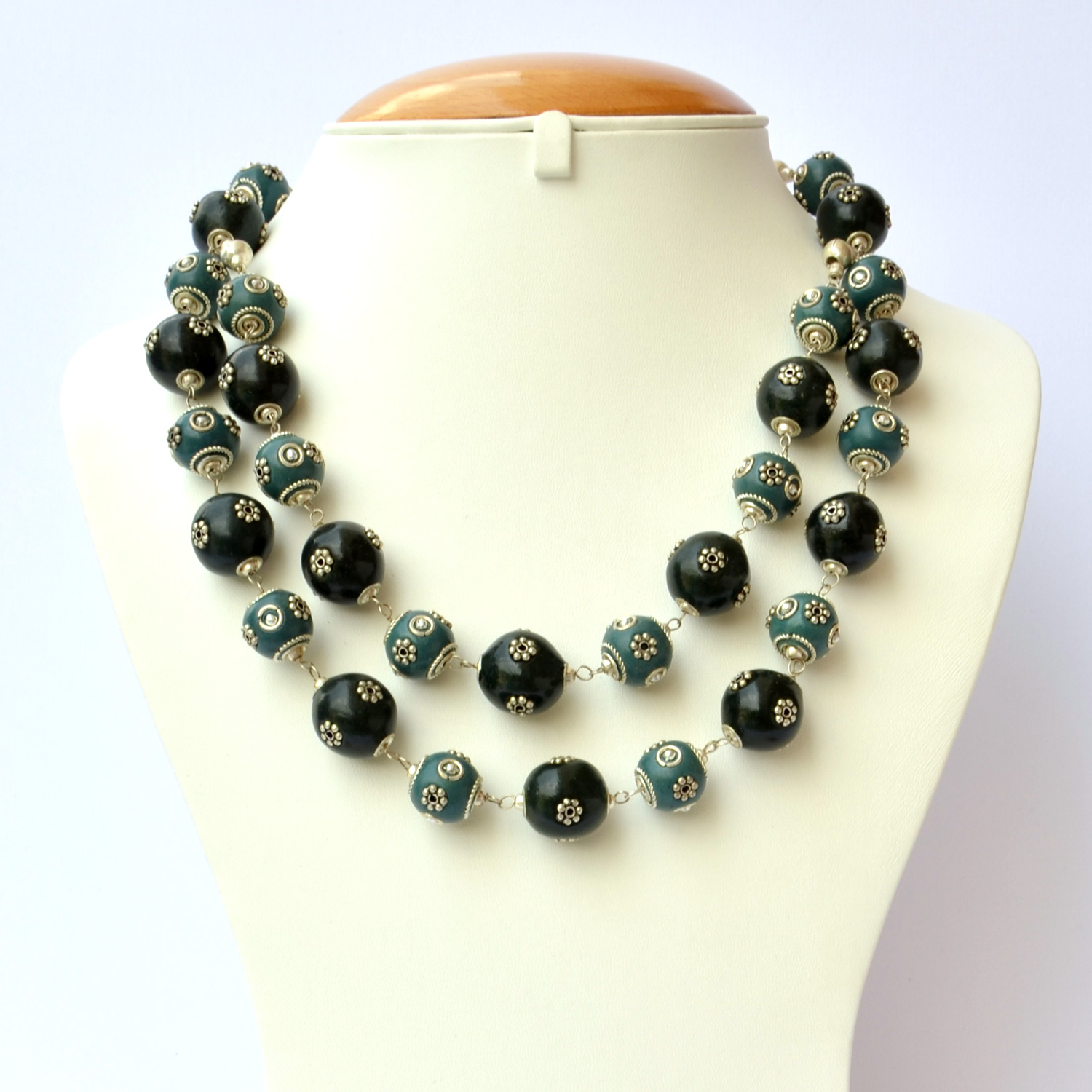 Handmade Necklace with Blue amp; Black Beads having Metal Flowers