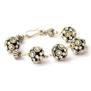 Handmade Bracelet having Black Beads with Metal Rings & Rhinestones