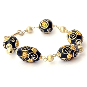 Handmade Bracelet having Black Beads with Metal Rings & Flowers