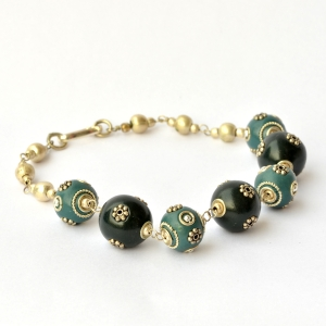 Handmade Bracelet having Black & Blue Beads Studded with Metal Flowers