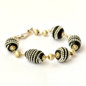 Handmade Bracelet having Black Beads Studded with Metal Chains