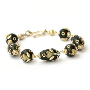 Handmade Bracelet having Black Beads Studded with Metal Hearts & Rings