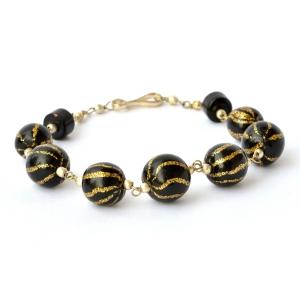Handmade Bracelet having Black Beads with Golden Stripes