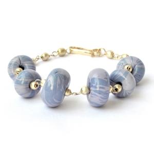 Handmade Bracelet having Disc Shaped Dark & Light Blue Color Beads