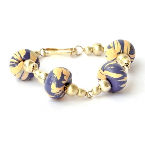 Handmade Bracelet having Purple Beads with Cream Stripes