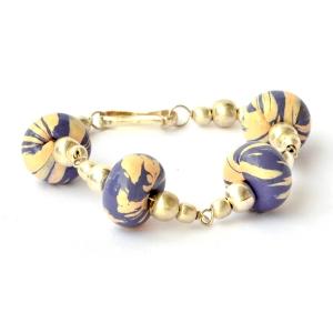 Handmade Bracelet having Purple Beads with Cream Stripes