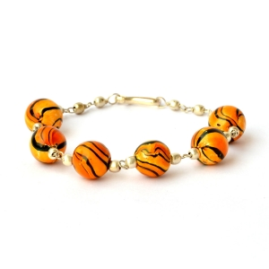 Handmade Bracelet having Orange Beads with Black Stripes