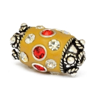 Yellow Cylindrical Beads Studded with Metal Rings & Rhinestones