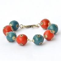 Handmade Bracelet having Red & Blue Beads with Metal Flowers