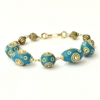 Handmade Bracelet having Blue Beads Studded with Metal Rings