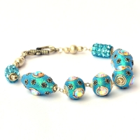 Handmade Bracelet having Aqua Glitter Beads with Metal Flowers & Rhinestones