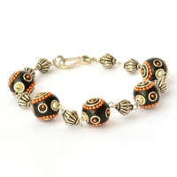 Handmade Bracelet having Black Beads with Orange Metal Chain