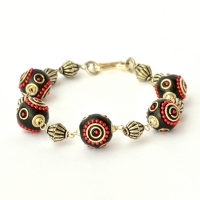 Handmade Bracelet having Black Beads with Red Metal Chain