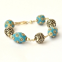 Handmade Bracelet having Blue Beads Studded with Metal Rings & Balls
