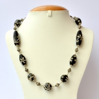 Handmade Necklace with Black Beads having Metal Accessories