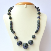 Handmade Necklace with Blue Beads having Green Spirals