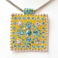 Handmade Yellow Pendant Studded with Metal Rings & Rhinestones